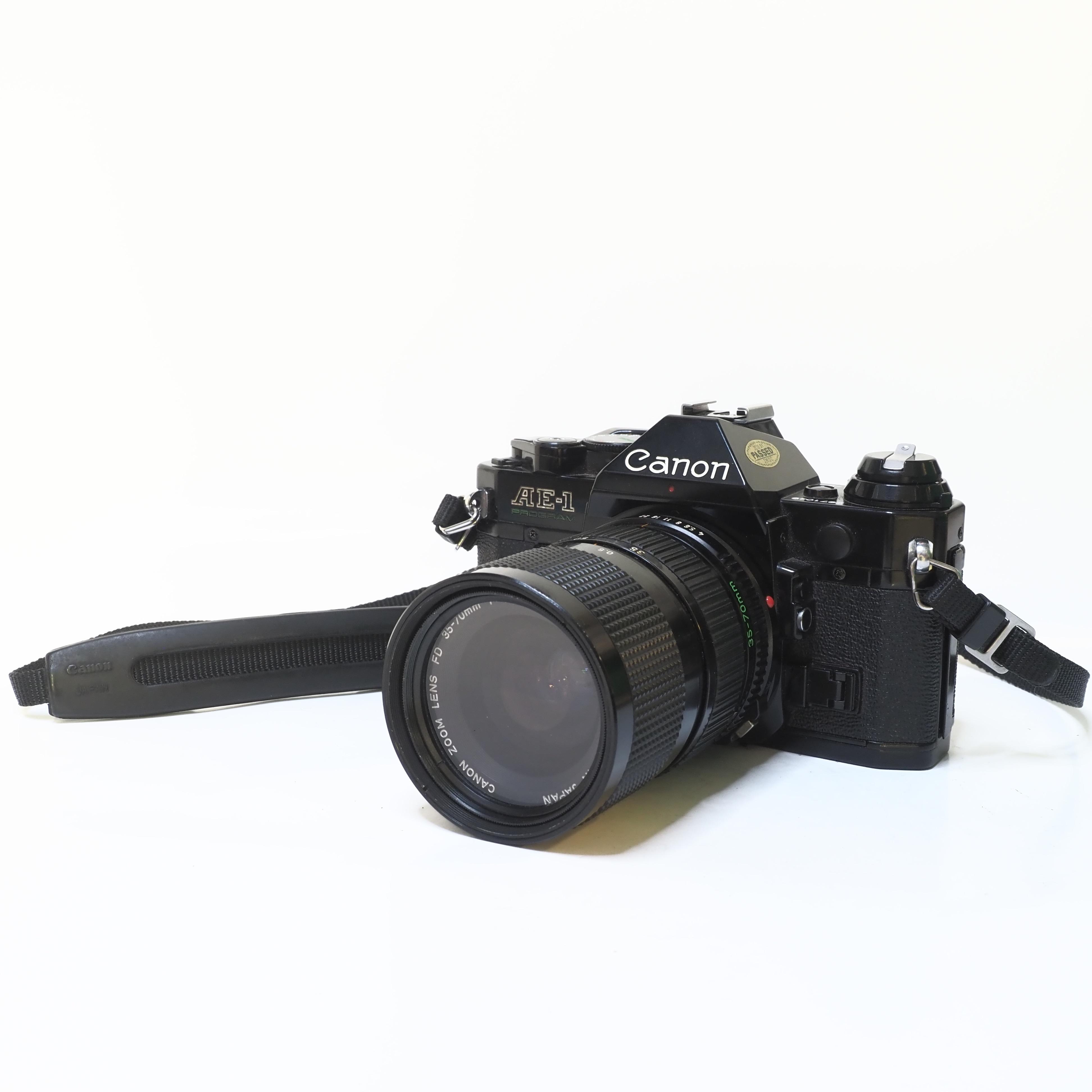 Canon AE-1 +Canon FD 35-70mm f/4 -BEGAGNAT